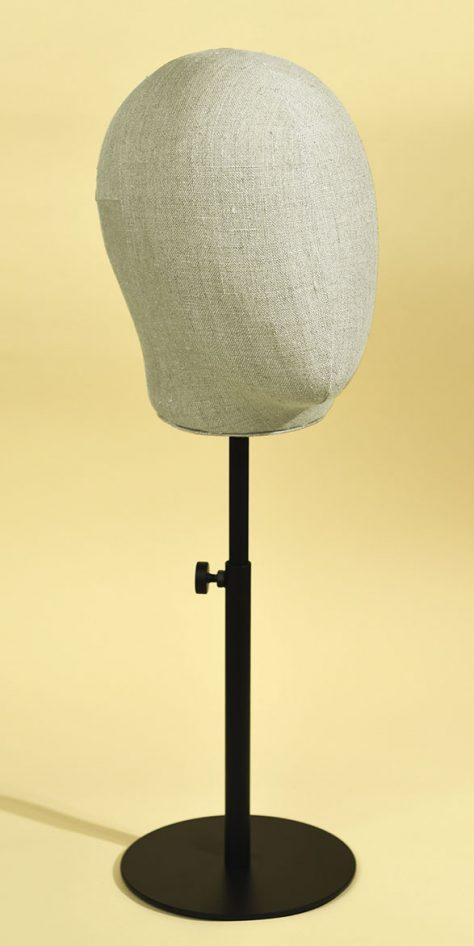 Man's mannequin head in handsewn linen blend with varnished, height-adjustable metal base