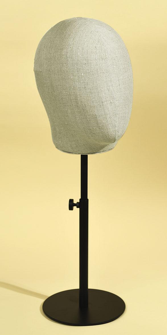Man's mannequin head in handsewn linen blend with varnished, height-adjustable metal base