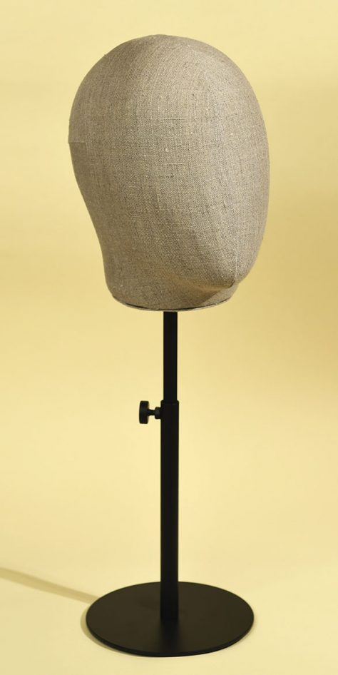 Man's mannequin head in handsewn rough linen with varnished, height-adjustable metal base