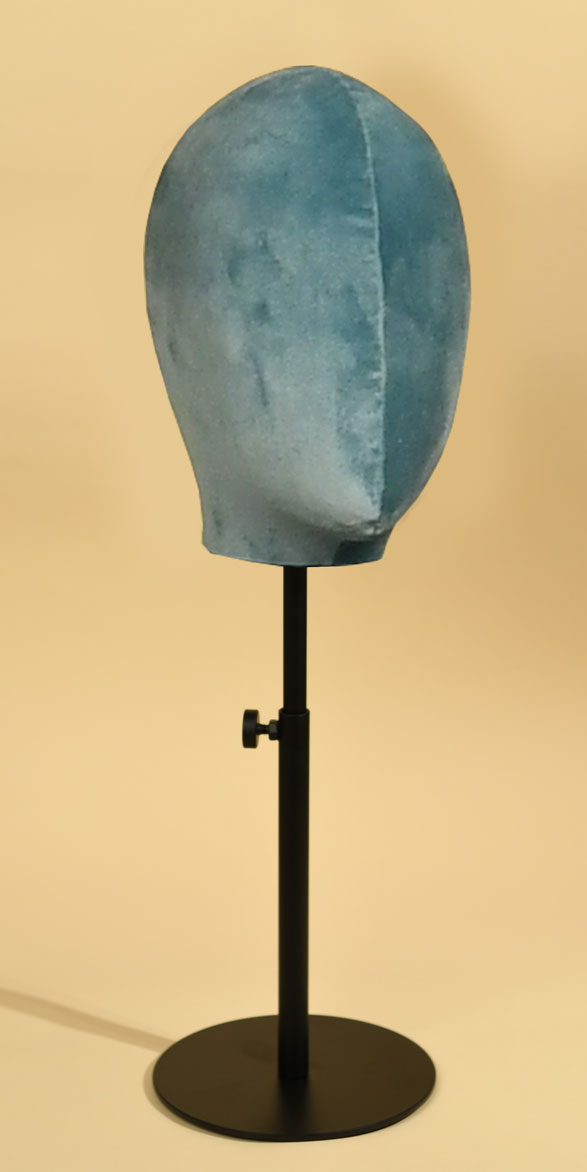 Woman's mannequin head in handsewn antique blue velvet with varnished, height-adjustable metal base