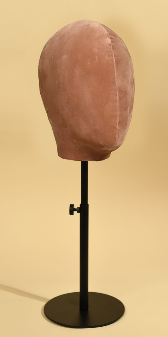 Woman's mannequin head in antique pink velvet with round, height-adjustable metal base