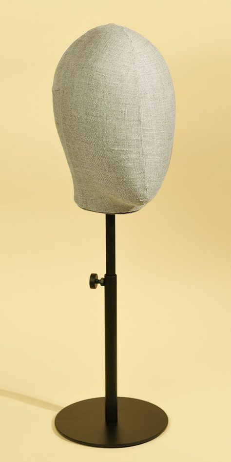Woman's mannequin head in linen blend with varnished, height-adjustable metal base